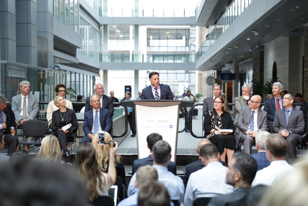 Minister of Economic Development, Employment and Infrastructure Brad Duguid announces the arrival of JLABS @ Toronto in the MaRS Discovery District. First row, left to right: Chris Halyk, president of Janssen Inc.; Melinda Richter, head of JLABS, Johnson & Johnson; Dr. Meric Gertler, president, University of Toronto; Minister Duguid; Dr. Ilse Treuricht, CEO MaRS Discovery District; Dr. Raphael (Rafi) Hofstein, president and CEO MaRS Innovation, and Robert Urban, head of Johnson & Johnson Innovation Boston. Second row: Dr. Robert Howard, president and CEO St. Michael's Hospital; Dr. Catherine Zahn, president and CEO CAMH; Dr. Barry McLellan, president and CEO Sunnybrook Health Sciences Centre; Dr. Peter Pisters, president & CEO University Health Network; Dr. Jim Woddgett, director of research, Lunenfeld-Tanenbaum Research Institute, Mount Sinai Hospital; and Dr. Michael Apkon, president and CEO, The Hospital for Sick Children.